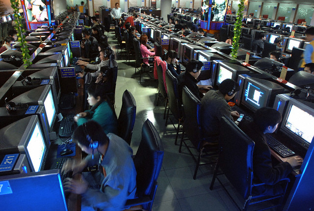Chinese use computers at Internet cafe in Nanjing